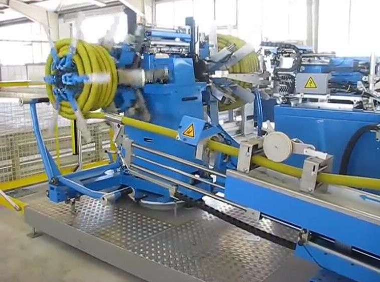 automatic coiler and strapping machine